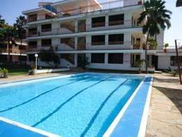 Modern 1 bedroom fully furnished holiday home with swimming pool