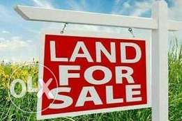 1 plot of land on a Dry Land sited at an already inhabited community