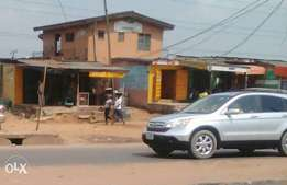 8rooms tenement building, with 3, shops in front at isolo Ikotun egbe