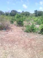 one acre land for sale at sun n' sand kikambala second row from beach