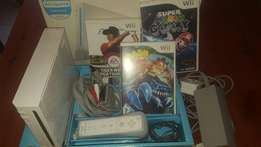WII console including 3 games