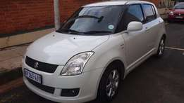 White Suzuki Swift