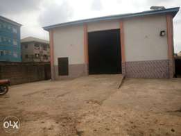 A warehouse and two plots of land for sale.