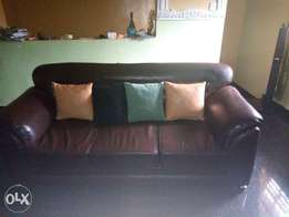 Brown leather 3seater sofa with throw pillows for grab