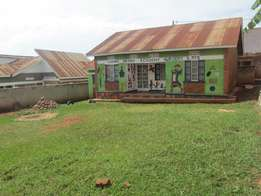 A four bed room house seated on 50x100 at 60m in Kirinya-Bweyogerere