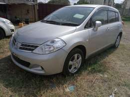 Nissan Tiida Hatchback KCM number 2010 model loaded with alloy rim