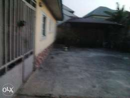 2 bedroom bungalow alone in the compound in Iwofe road by Ada George