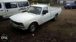 Peugeot 504 pickup manual petrol asking 250k