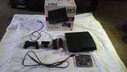 Ps3 with 1 3 controllers, the camera and 2 games for sale or swap