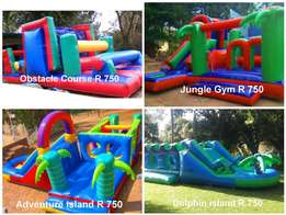 Jumping castle bubble machine banners waveslide gladiator and watersl