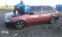 am selling my ford laser jst for 18.000 in complete parpers
