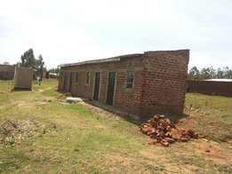 1/2 plot thats constructed with 4 single units for students.