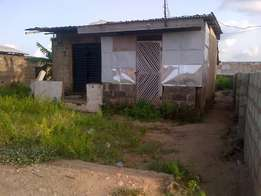 Bare land with shop for sale in Logoglogo, Ishawo-Ikorodu