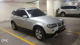 Car with Diplomat Number registration (BMW X3)