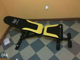 Everlast bench press plus dumbell weights and lift rod