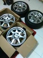 Tsw 15 inch mags with two tyres 50% life 4 stud with wheel nuts R1300