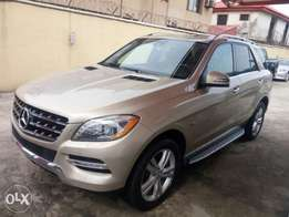 Very sharp gold color 2014 Mercedes Benz Ml350 4matic for sale. Ok