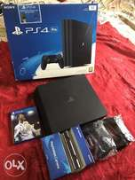 New Ps4 Pro, 2 dual shock pads,Ps4 camera,Fifa18,4 downloaded games.