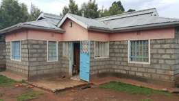 2 bedroom house in a 50x100 area 1.5kms from tarmac Gikambura.
