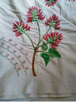 single thread embroideded choral tree on archer linen