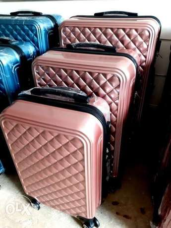 Swiss Suitcase Pink color set of 3 at 50%