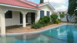-Property for sale in ukunda diani -Modern 3br bungalow on 1/4 acre -A