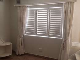 Two sets of cream curtains