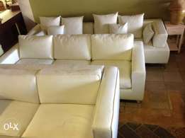 Assorted white leather couches