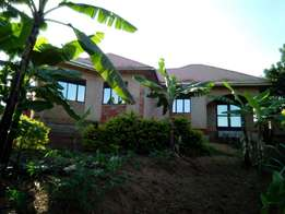 4bedroom home sitted on 25decimals in Kira at 180M