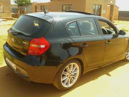 Bmw 1series, very neat. Call Mr Hadebe.