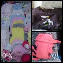baby clothes, baby bag and carrier