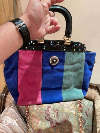 GIANNI VERSACE HAND BAG with precious stones on it, (1000+kd bag )