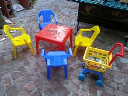Kiddies table and chairs set and trolley with groceries.