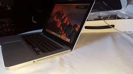 Neatly used Mac Book Pro for sale at a give away price