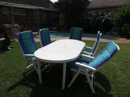 White Robust Plastic Table and Five Sturdy Plastic Chairs