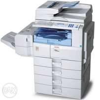 Ricoh mp c2050 photocopier, printer and a scanner