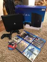Brand new PS4 PRO (1TB boxed) - 2 controllers & 7 top rated games