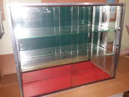 Two high quality Glass display cabinets with mirror back drop