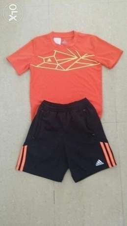 Original Adidas Climate sport set age 7-8 years + a pair of shins.