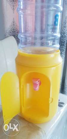Water dispenser with bottle