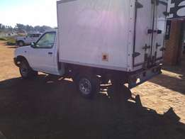 2 x Nissan hardbody with insulated canopies