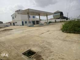 An Uncompleted Filing Station on 2 plots for sale along akala express
