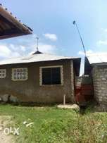 An income generating swahili house 5rooms and2shop for sale atksh 2.4m