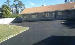 Tarred surfaces /driveways & parking areas.