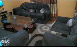 8seater sofas and coffee table...sofas 28k coffee table 15k