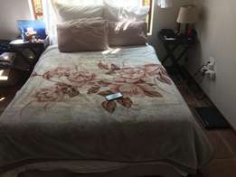bed with linen and pillows for sale