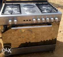 Scanfrost 2 electric and 4 burner gas cooker