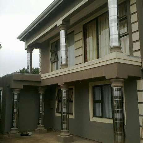 stainless pillar covers and guters installer Ekangala - image 3
