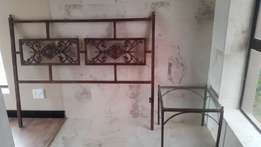 Wrought-iron head board and two side tables