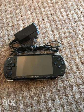 sony psp black + power + cover very good condition